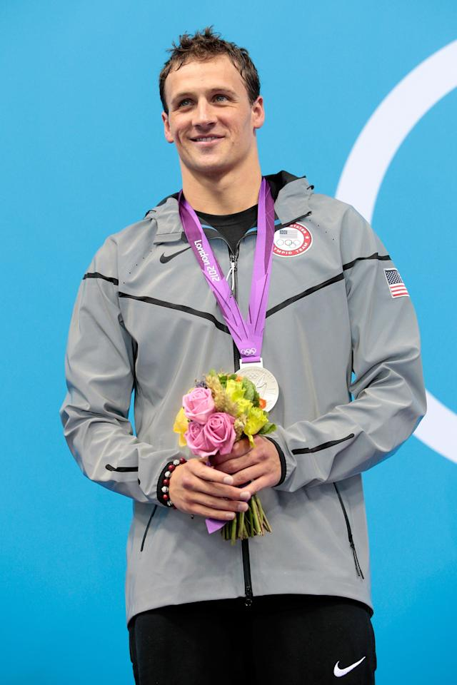 LONDON, ENGLAND - AUGUST 02: Silver medallist Ryan Lochte of the United States poses on the podium during the medal ceremony for the Men's 200m Individual Medley final on Day 6 of the London 2012 Olympic Games at the Aquatics Centre on August 2, 2012 in London, England. (Photo by Adam Pretty/Getty Images)