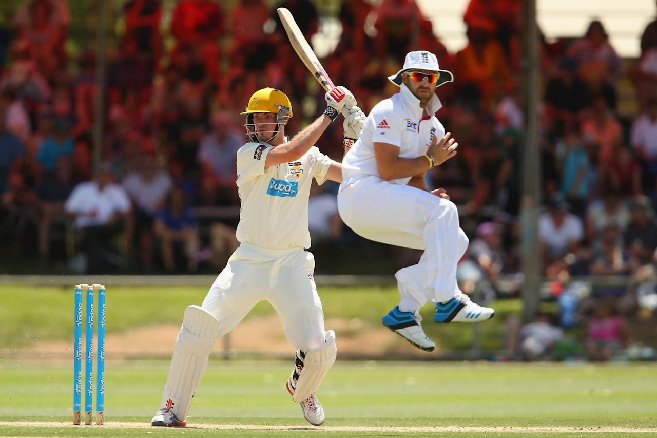 ALICE SPRINGS, AUSTRALIA - NOVEMBER 30: Ashton Turner of the Chairman's XI cuts a ball as Matt Prior of England jumps to avoid being hit during day two of the tour match between the Chairman's XI and England at Traeger Park Oval on November 30, 2013 in Alice Springs, Australia.  (Photo by Mark Kolbe/Getty Images)