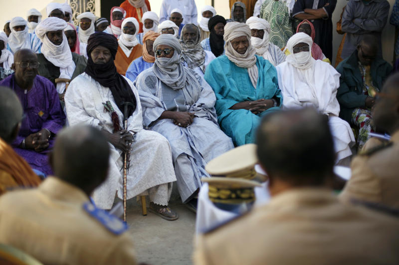 Elders meet with the mayor and the governor of Gao in the city of Gao, Northern Mali, Wednesday Jan. 30, 2013. All tribe leaders were called to attend the meeting  in an effort to avoid vengeance attacks following the arrival of French and Chadian troops in the area, ending 10-months of sharia laws.  (AP Photo/Jerome Delay)