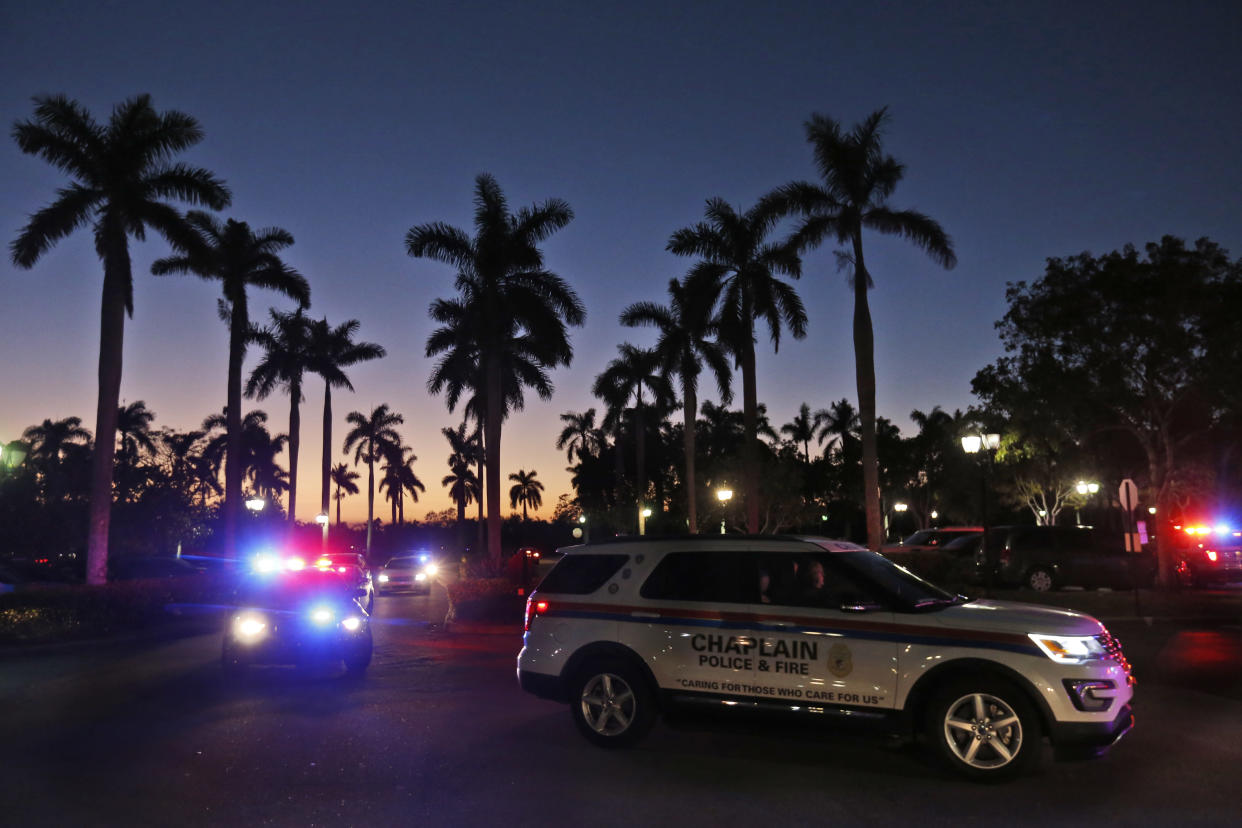 Law enforcement vehicles arrive at the hotel in Coral Springs, Fla., where parents were instructed to pick up their children Wednesday night. (Photo: Wilfredo Lee/AP)