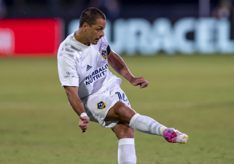 ORLANDO, FL - JULY 13: Los Angeles Galaxy forward Javier Hernandez (14) shoots the ball during the MLS Is Back Tournament between the LA Galaxy v Portland Timbers on July 13, 2020 at the ESPN Wide World of Sports, Orlando FL. (Photo by Andrew Bershaw/Icon Sportswire via Getty Images)
