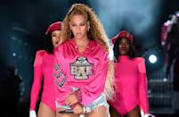 """<p>During the second weekend of Coachella, Beyoncé rocked the same looks as the first week - but in all new colours. The yellow hoodie she wore for the first weekend performance was replaced by this hot pink version. The sequinned letters–her initials and the Greek delta symbol–are in a collegiate style, which fit with her big band accompaniment. The sweatshirt draws on the Greek lettering of American sororities, where black women have historically had to fight for their place. Beyoncé took a recognisable style ingrained in American culture, made it her own, and performed """"Lift Every Voice and Sing,"""" which is considered to be the black national anthem. </p>"""
