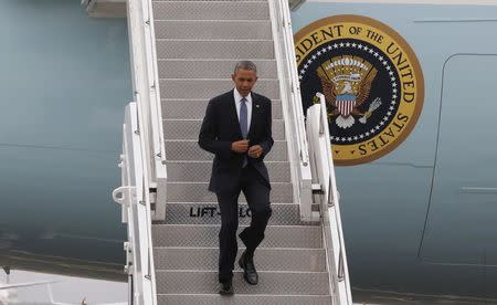 U.S. President Obama walks off Air Force One at Boeing Field/King County International Airport in Seattle, Washington