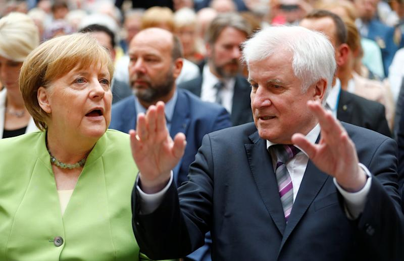 German Chancellor Angela Merkel and German Interior minister Horst Seehofer are at odds over the Germany's immigration policies.