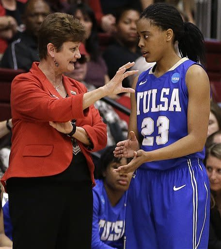Tulsa coach Matilda Mossman, left, speaks with guard Ashley Clark (23) during the first half of a first-round game in the women's NCAA college basketball tournament against Stanford, Sunday, March 24, 2013, in Stanford, Calif. (AP Photo/Ben Margot)