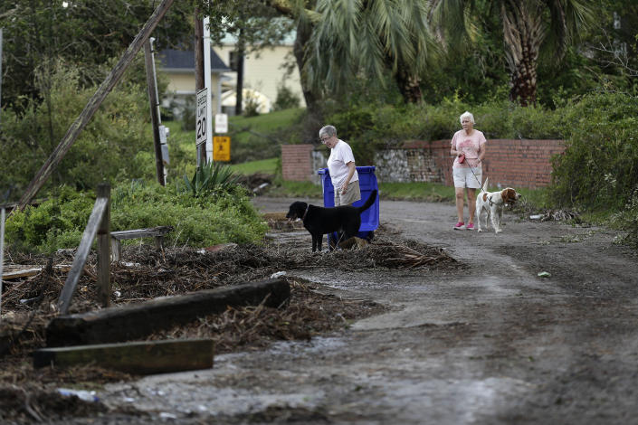 Residents survey the damage following the effects of Hurricane Isaias in Southport, N.C., Tuesday, Aug. 4, 2020. (AP Photo/Gerry Broome)