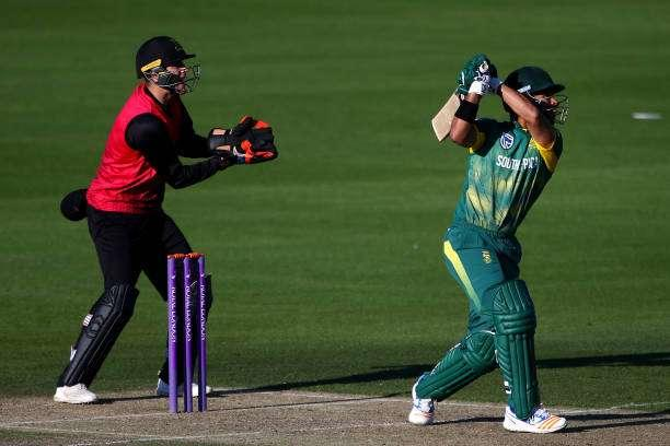 HOVE, ENGLAND - MAY 19: JP Duminy of South Africa hits out while Sussex wicket keeper Michael Burgess looks on during the Tour Match between Sussex and South Africa at The 1st Central County Ground on May 19, 2017 in Hove, England. (Photo by Charlie Crowhurst/Getty Images)
