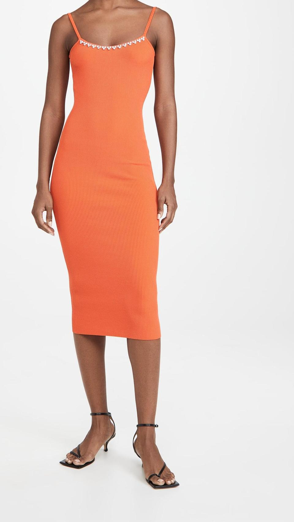 <p>This <span>Area Rib Knit Midi Dress</span> ($272, originally $680) is the kind of head-turning look you'll absolutely make a statement in. We love the pop of color and the fitted yet slightly stretchy silhouette.</p>