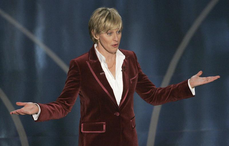 FILE - In this Feb. 25, 2007 file photo, Oscar host Ellen DeGeneres opens the 79th Academy Awards telecast, in Los Angeles. DeGeneres is returning as host at the 86th Academy Awards on March 2, 2014, after making her Oscar debut in 2007 and she's had a close hand in the writing process, Neil Meron said. (AP Photo/Mark J. Terrill, file)