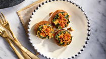 """<p><strong>Recipe: <a href=""""https://www.southernliving.com/recipes/spinach-stuffed-mushrooms"""" rel=""""nofollow noopener"""" target=""""_blank"""" data-ylk=""""slk:Spinach-Stuffed Mushrooms"""" class=""""link rapid-noclick-resp"""">Spinach-Stuffed Mushrooms</a></strong></p> <p>Get the taste of spinach dip in handheld form when you serve it in a button mushroom. </p>"""