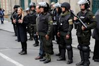 Bolivian Interim President Jeanine Anez takes part in a ceremony with the police in front of the Presidential Palace, in La Paz