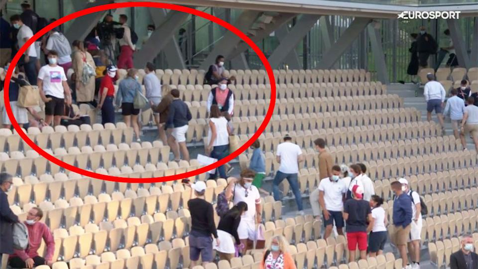Seen here, French Open fans leave before a 9pm Covid curfew in Paris.