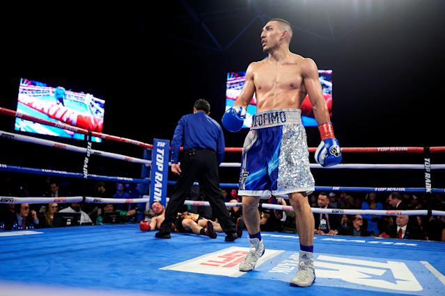 Teofimo Lopez faces the crowd after flattening Diego Magdaleno during a lightweight boxing match Feb. 2, 2019, in Frisco, Texas. (AP)