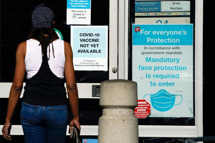 A COVID-19 sign greets a resident in Long Beach, part of an area of Southern California that has been slammed by coronavirus infections since the Thanksgiving break.