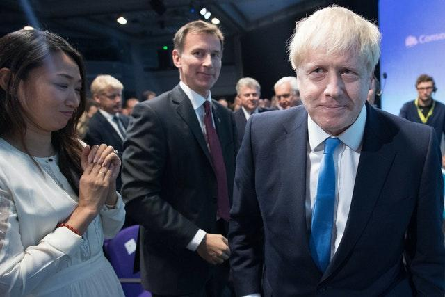 Jeremy Hunt watches as Boris Johnson is announced as the new Conservative Party leader