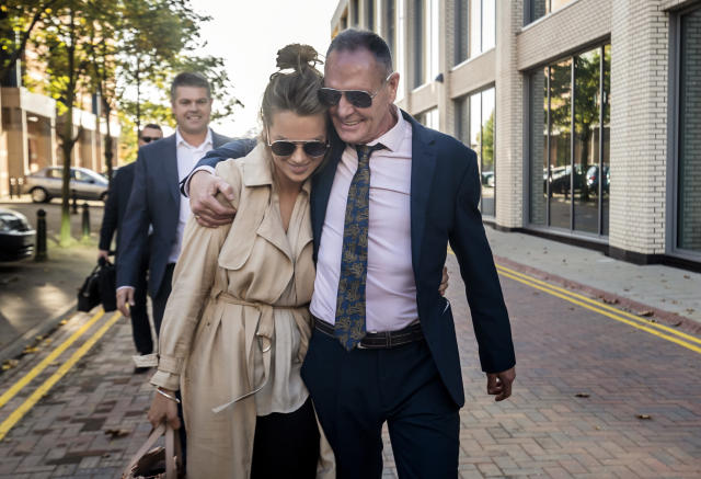 Paul Gascoigne and his manager Katie Davies leaving court after he was cleared of sexual assault (Credit: PA)