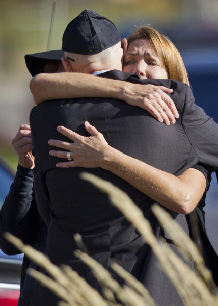 Shereen Rahamim hugs a mourner as she arrives at the funeral for her husband, Reuven Rahamim, at Beth El Synagogue in St. Louis Park, Minn., on Sunday, Sept. 30, 2012. Reuven Rahamim was killed in a workplace shooting Thursday. (AP Photo/Star Tribune, Renee Jones Schneider)