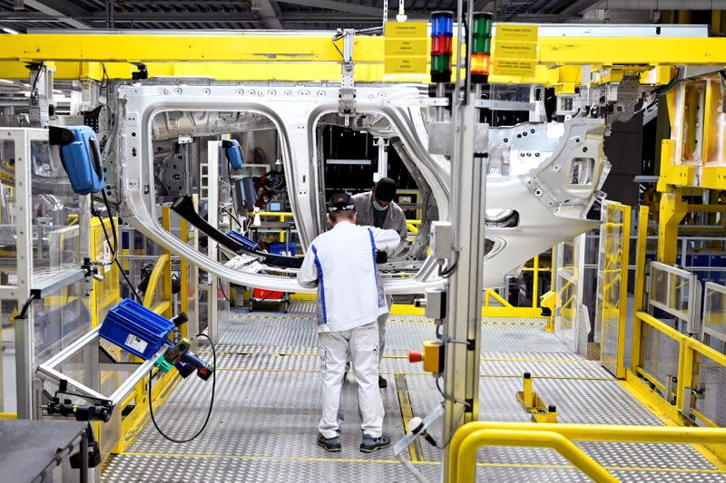 FILE PHOTO: Employees work on an assembly line as the Volkswagen construction plant reopens after closing down last month due to the coronavirus disease (COVID-19) outbreak in Bratislava