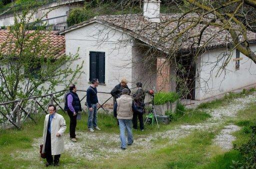 <p>Judges and lawyers inspect on April 18, 2009 the cottage in Perugia where Meredith Kercher was found dead. Kercher, 21, was found half-naked with her throat slashed in a pool of blood in her bedroom in the house that she shared with Knox.</p>