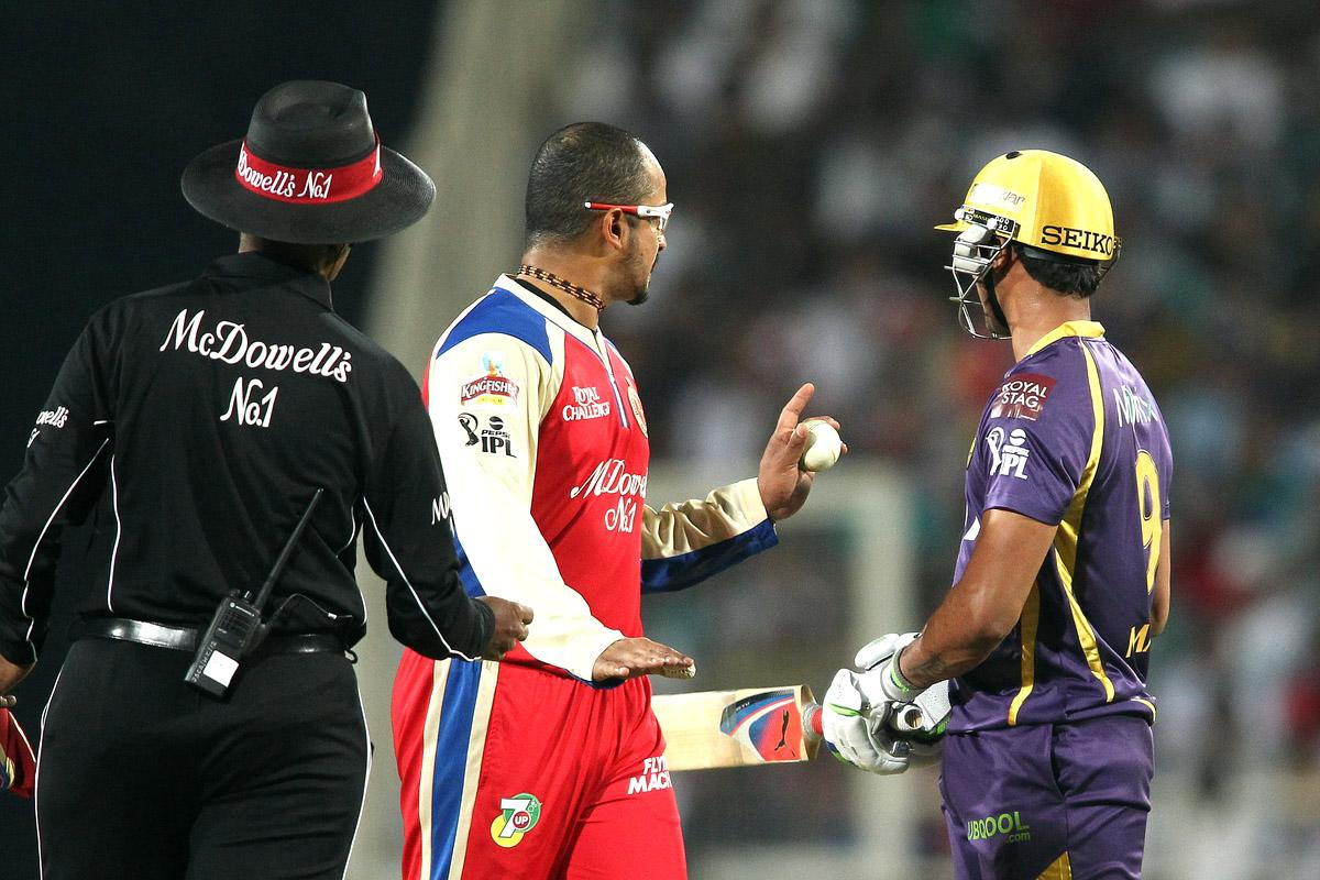 Murali Kartik of the Royal Challengers Bangalore warms Manoj Tiwary of Kolkata Knight Riders about backing up too far during match 60 of the Pepsi Indian Premier League between The Kolkata Knight Riders and the Royal Challengers Bangalore held at the JSCA International Stadium Complex, Ranchi, India on the 12th May 2013. (BCCI)