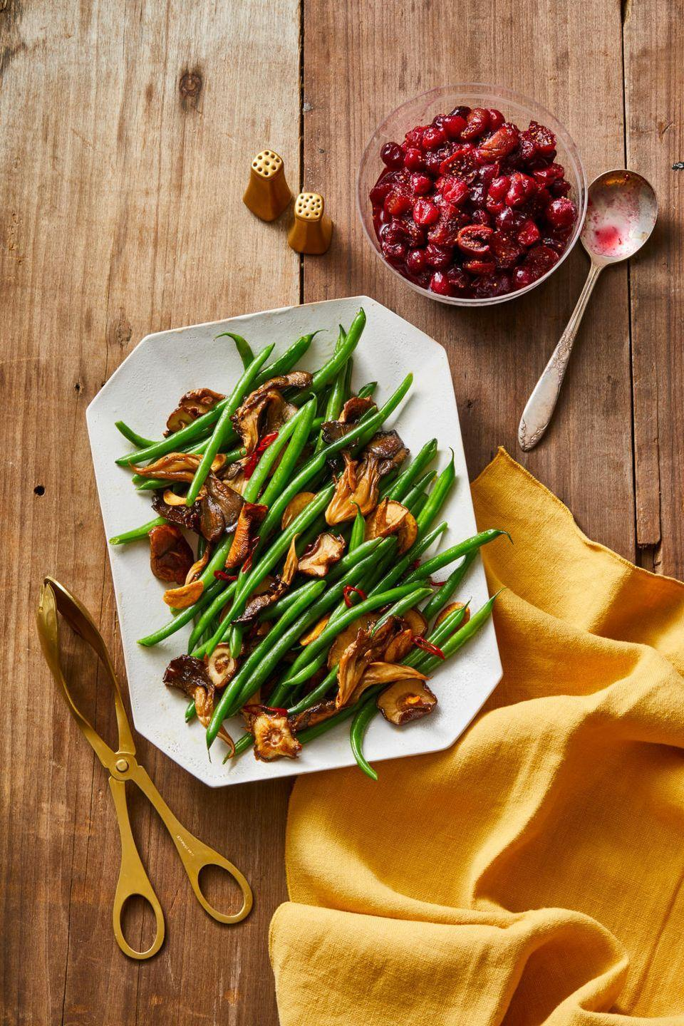 """<p>It's the ultimate side dish; ready in under half-an-hour, can be roasted in the oven while you work the stovetop, and clears out your veggie drawer.</p><p><a href=""""https://www.goodhousekeeping.com/food-recipes/a34360532/chile-garlic-green-beans-recipe/"""" rel=""""nofollow noopener"""" target=""""_blank"""" data-ylk=""""slk:Get the recipe for Mushroom and Chile-Garlic Green Beans »"""" class=""""link rapid-noclick-resp""""><em>Get the recipe for Mushroom and Chile-Garlic Green Beans »</em></a><br></p>"""