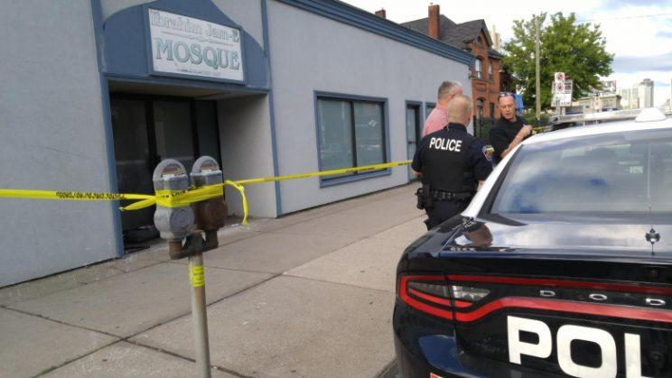 Police at the scene of a suspected arson attack against a Hamilton mosque earlier in September. From CBC.