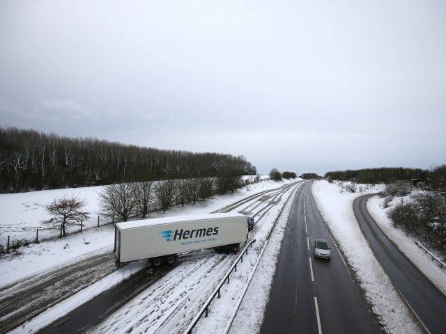A lorry stuck on the A14 in Northampton (PA)