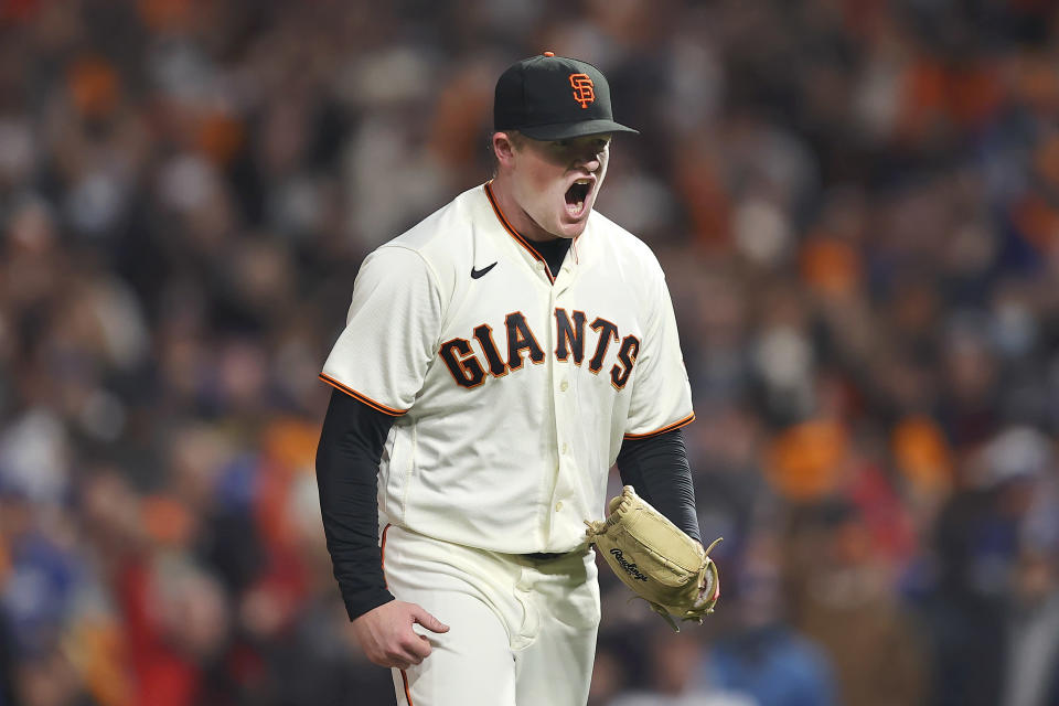 San Francisco Giants pitcher Logan Webb reacts after striking out Los Angeles Dodgers' Trea Turner during the sixth inning of Game 1 of a baseball National League Division Series Friday, Oct. 8, 2021, in San Francisco. (AP Photo/John Hefti)