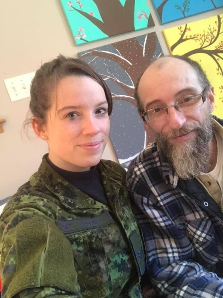 Tiffany Mackey poses with her father while helping out in Newfoundland. (Photo: Provided Tiffany Mackey)