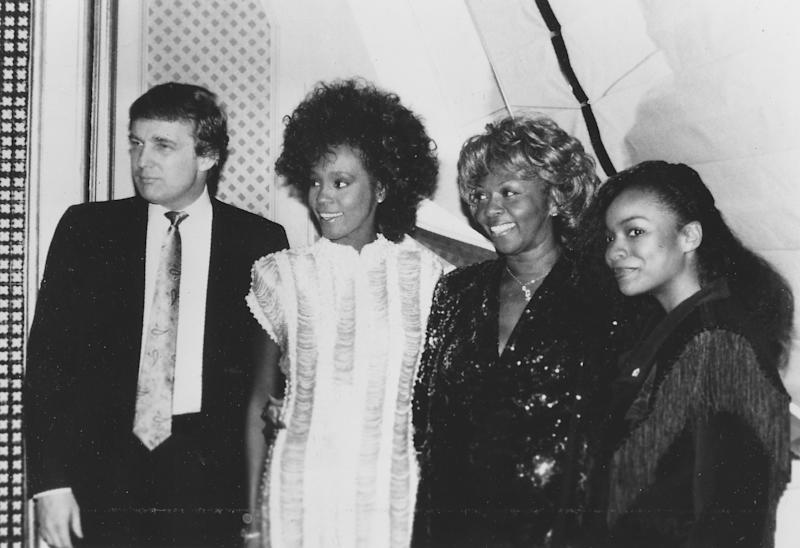 Donald Trump with singers Whitney Houston, center, and her mother, Cissy Houston, and an unidentified woman in San Francisco in 1980.