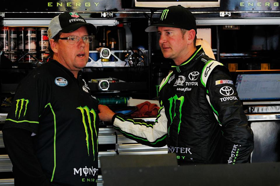 <em>Crew chief Mike Beam talks with Kurt Busch during Nationwide Series practice April 12, 2012 at Texas Motor Speedway (Tyler Barrick/Getty Images for NASCAR).</em>