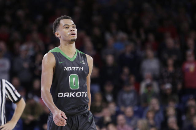 """North Dakota guard <a class=""""link rapid-noclick-resp"""" href=""""/ncaab/players/127160/"""" data-ylk=""""slk:Geno Crandall"""">Geno Crandall</a> (0) walks on the court during overtime in an NCAA college basketball game against Gonzaga in Spokane, Wash., Saturday, Dec. 16, 2017. (AP Photo/Young Kwak)"""