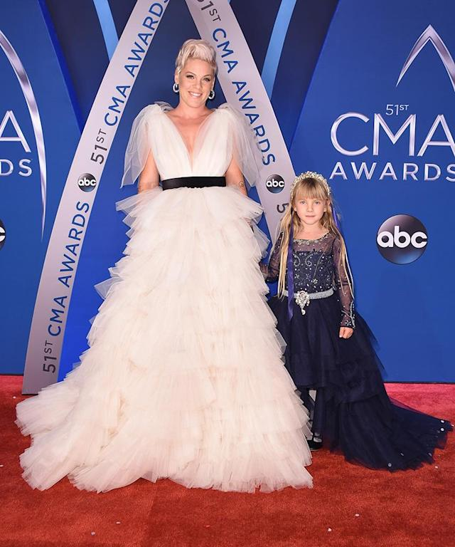 <p>The stunning mother-daughter team hit the CMAs red carpet looking like the queens that they are. The singer dazzled in an etheral white gown, while her mini-me rocked a bejewled tiara like nobody's business. Shine on, ladies! (Photo: Michael Loccisano/Getty Images) </p>