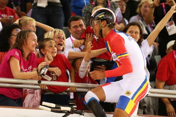 Carol-Eduard Novak of Romania celebrates winning gold in Men's Individual C4 Pursuit Final on day 3 of the London 2012 Paralympic Games at Velodrome on September 1, 2012 in London, England. (Photo by Bryn Lennon/Getty Images)