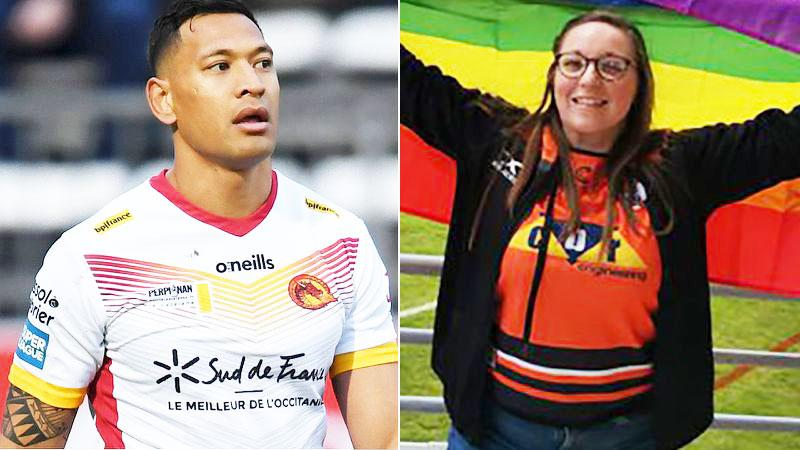 Pictured on the right, a fan holds a rainbow flag in protest of Israel Folau's beliefs.