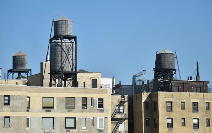 Water tanks, similar to those made by Hall-Woolford, are seen in New York in May 2018 (AFP/Hector RETAMAL)