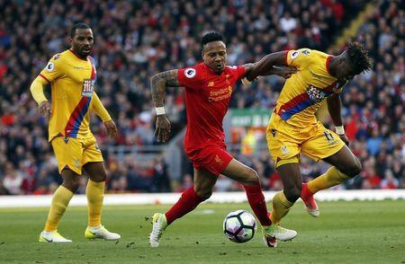 Britain Football Soccer - Liverpool v Crystal Palace - Premier League - Anfield - 23/4/17 Liverpool's Nathaniel Clyne in action with Crystal Palace's Wilfried Zaha Action Images via Reuters / Paul Childs Livepic