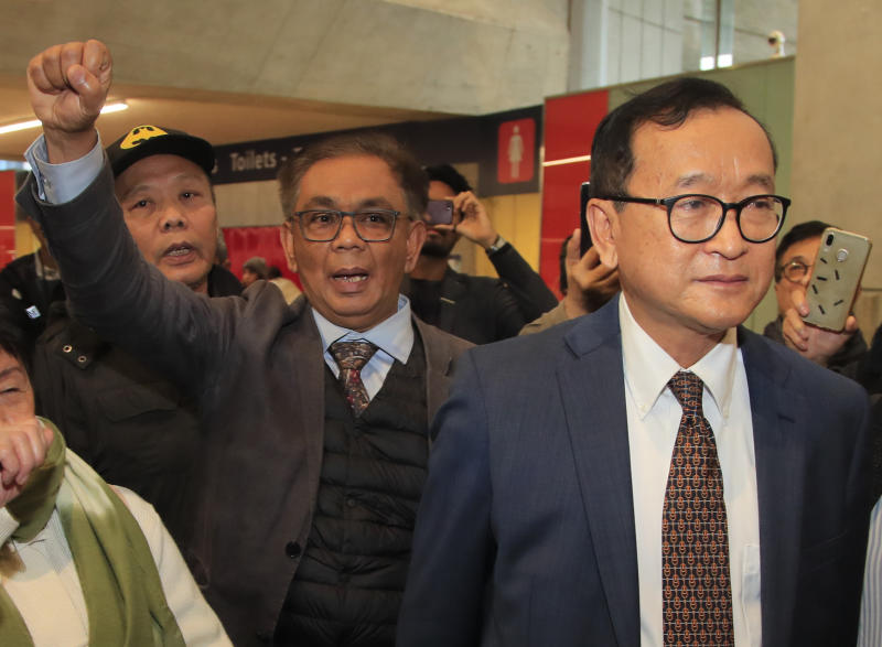 Cambodia's most prominent opposition politician Sam Rainsy gather with supporters as he attempted to return to Cambodia Thursday, Nov. 7, 2019 at Charles de Gaulle airport, north of Paris. Cambodia's main opposition figure Sam Rainsy said he was turned away from boarding a Thai Airways flight from Paris-Bangkok in his attempt to return to Cambodia from his self-imposed exile to challenge the longtime leader there. (AP Photo/Michel Euler)