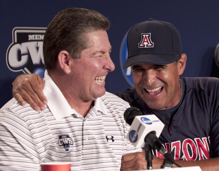 South Carolina coach Ray Tanner, left, and Arizona coach Andy Lopez joke during a news conference Saturday, June 23, 2012, ahead of the NCAA College World Series baseball finals at TD Ameritrade Pard in Omaha, Neb. South Carolina and Arizona will plan starting Sunday in the best-of-three games championship. (AP Photo/Nati Harnik)