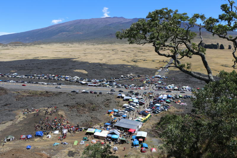 In this Sunday, July 21, 2019, photo provided by the Hawaii Department of Land and Natural Resources, protesters block a road to the summit of Mauna Kea in Hawaii. Scientists want to build the telescope atop Mauna Kea because it is one of the best sites in the world for viewing the skies. Hawaii Gov. David Ige has ordered the closure of the road as a way to clear a path for construction equipment. (Dan Dennison/Hawaii Department of Land and Natural Resources via AP)