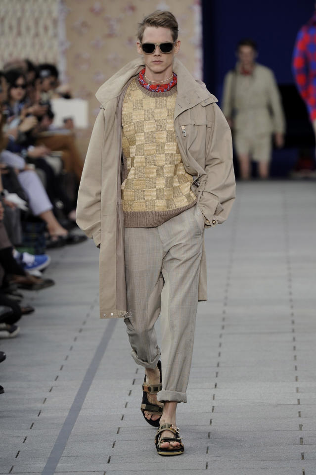 <p>For Jones's first collection for Louis Vuitton, a male model wore a look inspired by the designer's travels to Africa and the Amazon, featuring khaki, sandals, and African prints. (Photo: Catwalking) </p>