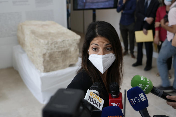 Rome's Mayor Virginia Raggi, answers to journalists' questions, during the presentation to the press of an archeological finding emerged during the excavations at a Mausoleum in Rome, Friday, July 16, 2021. The monumental pomerial stone is dating back to Roman Emperor Claudio and was used to mark the 'pomerium' the sacred boundaries of the 'Urbe', the city of Rome, during the Roman empire. (AP Photo/Domenico Stinellis)