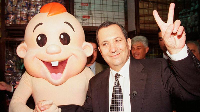 Former Israeli Prime Minister Ehud Barak and the Bamba Baby at the Bamba factory in 1999