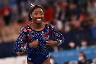 <p>USA's Simone Biles reacts after competing in the artistic gymnastics balance beam event of the women's qualification during the Tokyo 2020 Olympic Games at the Ariake Gymnastics Centre in Tokyo on July 25, 2021. (Photo by Loic VENANCE / AFP) (Photo by LOIC VENANCE/AFP via Getty Images)</p>