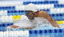 Michael Phelps swims in the men's 400-meter individual medley preliminaries at the U.S. Olympic swimming trials, Monday, June 25, 2012, in Omaha, Neb. (AP Photo/David Phillip)