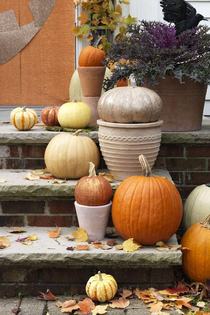 """<p>For something a bit more sophisticated and subtle, blast your pumpkins with glitter spray paint and create a charming front porch display. So easy!<br></p><p><a class=""""link rapid-noclick-resp"""" href=""""https://www.amazon.com/Krylon-K03804A00-Glitter-Blast-Diamond/dp/B005574IT2?tag=syn-yahoo-20&ascsubtag=%5Bartid%7C10070.g.1902%5Bsrc%7Cyahoo-us"""" rel=""""nofollow noopener"""" target=""""_blank"""" data-ylk=""""slk:SHOP GLITTER BLAST SPRAY PAINT"""">SHOP GLITTER BLAST SPRAY PAINT</a></p>"""
