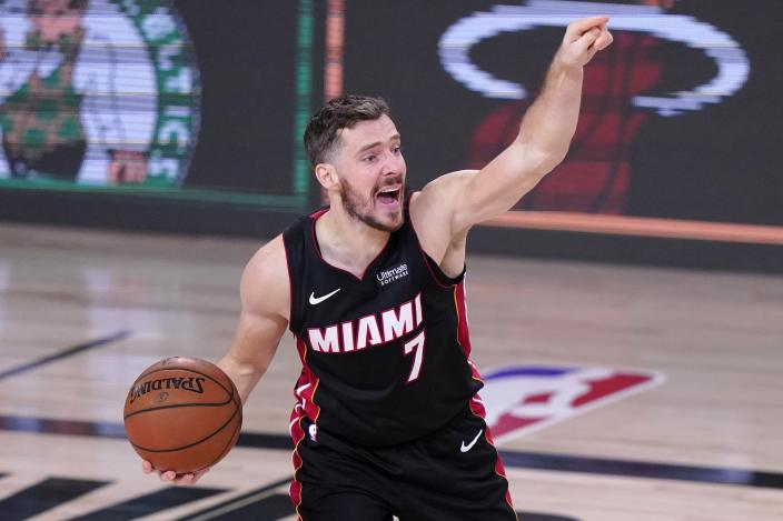 Miami Heat's Goran Dragic (7) gestures as he handles the ball during the first half of an NBA conference final playoff basketball game against the Boston Celtics on Saturday, Sept. 19, 2020, in Lake Buena Vista, Fla. (AP Photo/Mark J. Terrill)