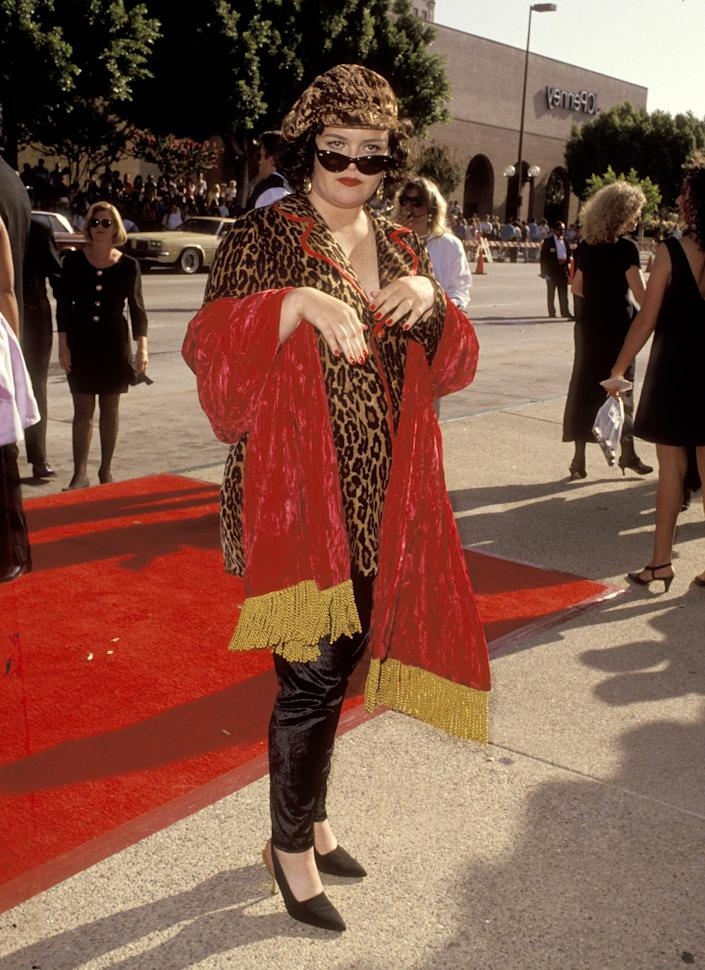 Rosie O'Donnell dressed in cheetah print and red blanket