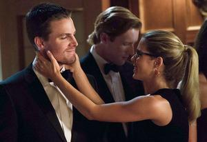 Stephen Amell, Emily Bett Rickards | Photo Credits: Jack Rowand/The CW