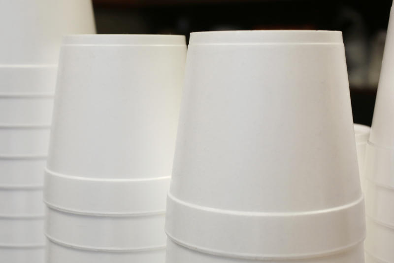 FILE - In this Feb. 14, 2013 file photo, polystyrene foam soup containers are stacked in a New York restaurant. Maine is banning single-use food and drink containers made from polystyrene foam. Democratic Gov. Janet Mills signed the bill into law Tuesday, April 30, 2019; environmental advocates say that makes Maine the first state to ban disposable foam food containers. Supporters say the law, which goes into effect Jan. 1, 2021, will reduce litter in the state's lakes, rivers and coastal waters. (AP Photo/Mark Lennihan, File)